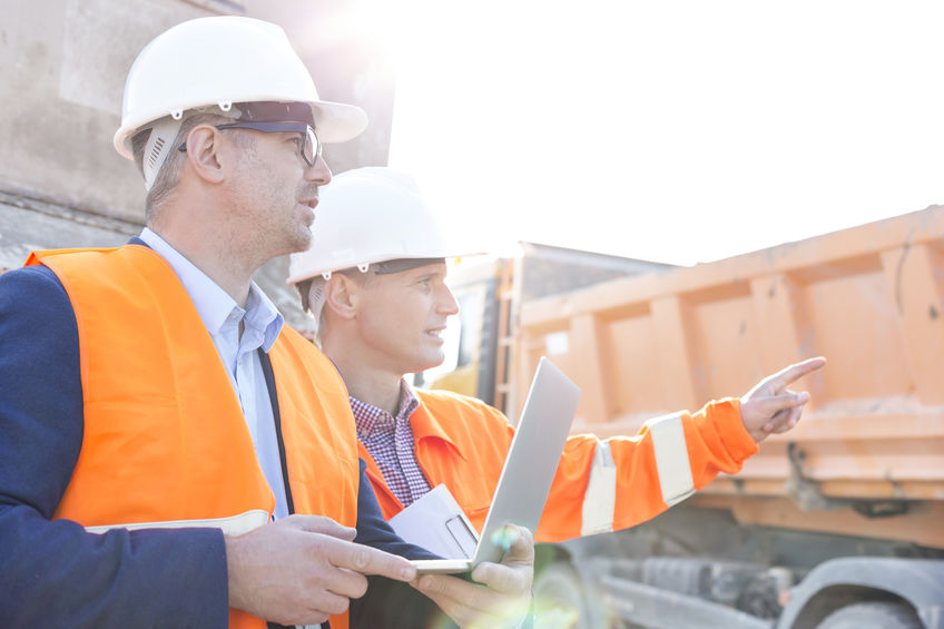Product overview of general contractor using CMPRO™ Construction Management Software Simplified™ at job site with superintendent to manage construction costs.
